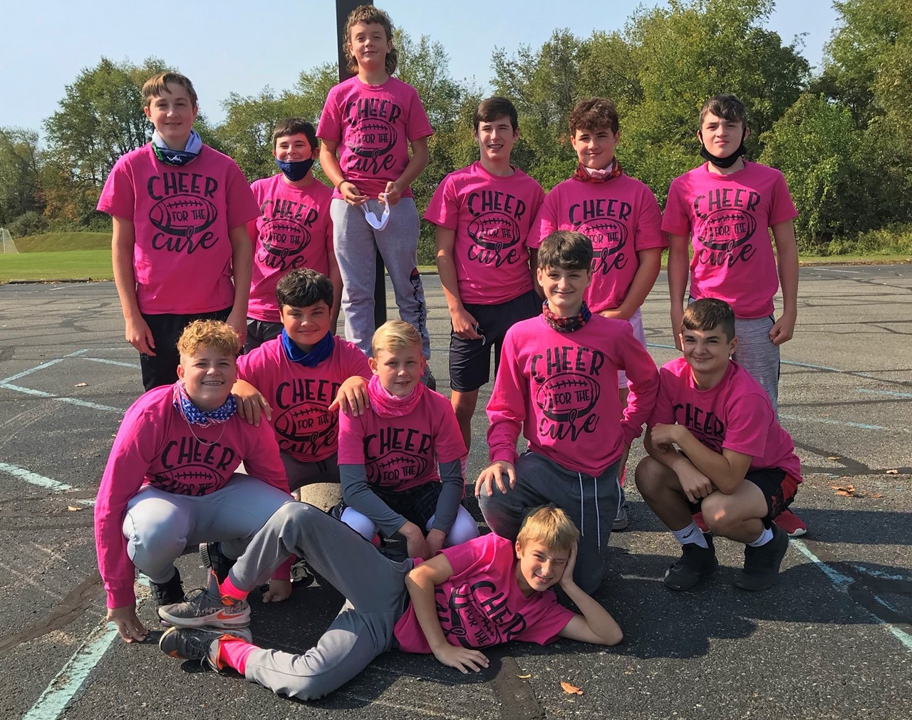 7th Grade Football Team Wears Pink For Cheer For The Cure